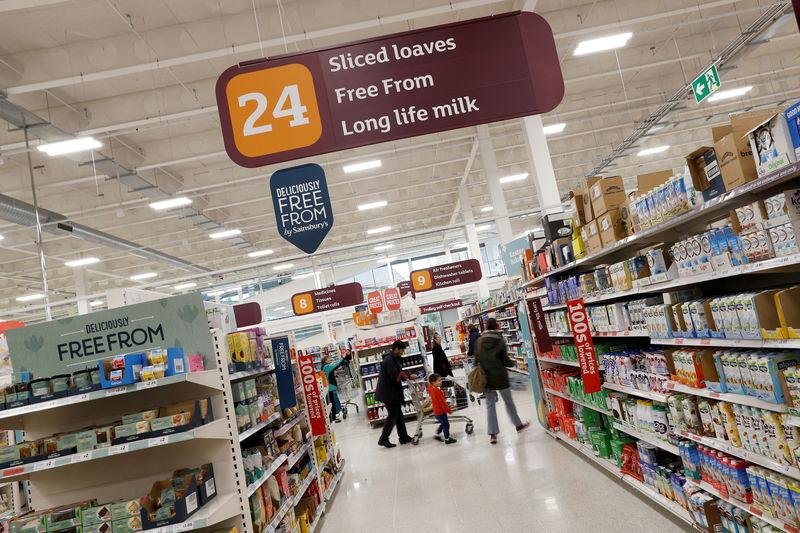 FILE PHOTO: Customers shop in a Sainsbury's store in Redhill, Britain