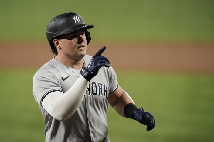 New York Yankees' Luke Voit gestures while running the bases after hitting a solo home run off Baltimore Orioles starting pitcher Alexander Wells during the third inning of a baseball game, Tuesday, Sept. 14, 2021, in Baltimore. (AP Photo/Julio Cortez)