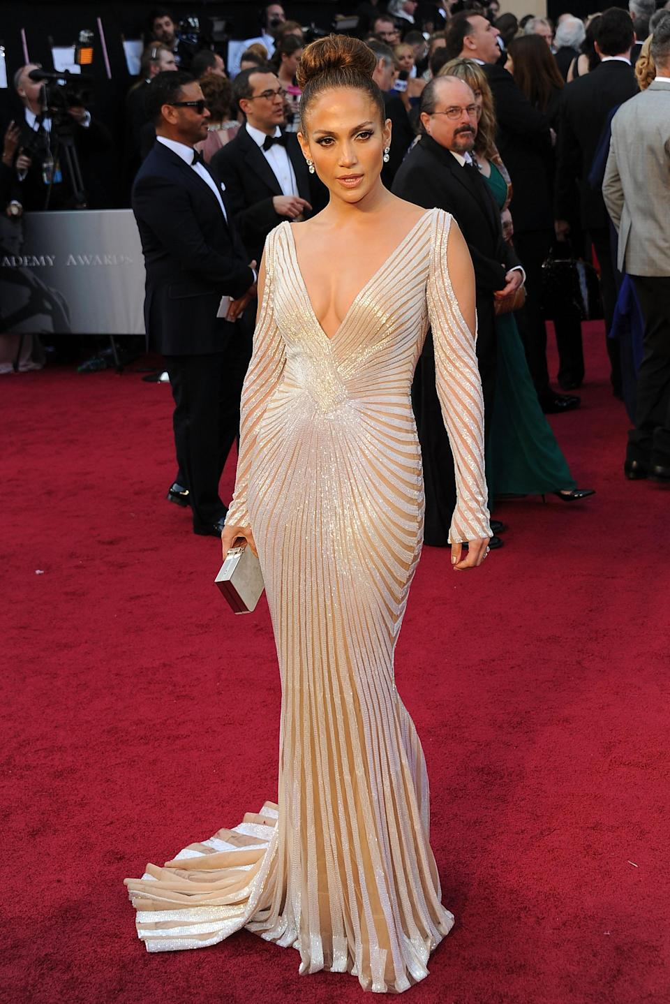 <p>Ah, 2012, the year of the J.Lo and Enrique Igleasias tour. With her fitness at an all-time high and sporting a peak touring bod, J.Lo stuns in this Grecian-inspired dress with a deep neckline and curve-hugging silhouette. [Photo: Getty] </p>