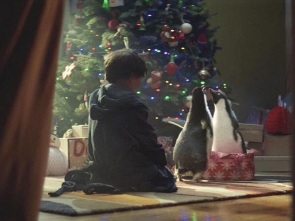 Pick up a penguin: John Lewis's emotional 'story' is part of a £7m festive store campaign (PA)