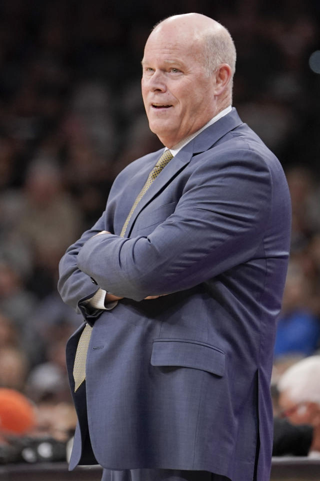 Orlando Magic head coach Steve Clifford watches play during the second half of an NBA preseason basketball game against the San Antonio Spurs, Saturday, Oct. 5, 2019, in San Antonio. (AP Photo/Darren Abate)