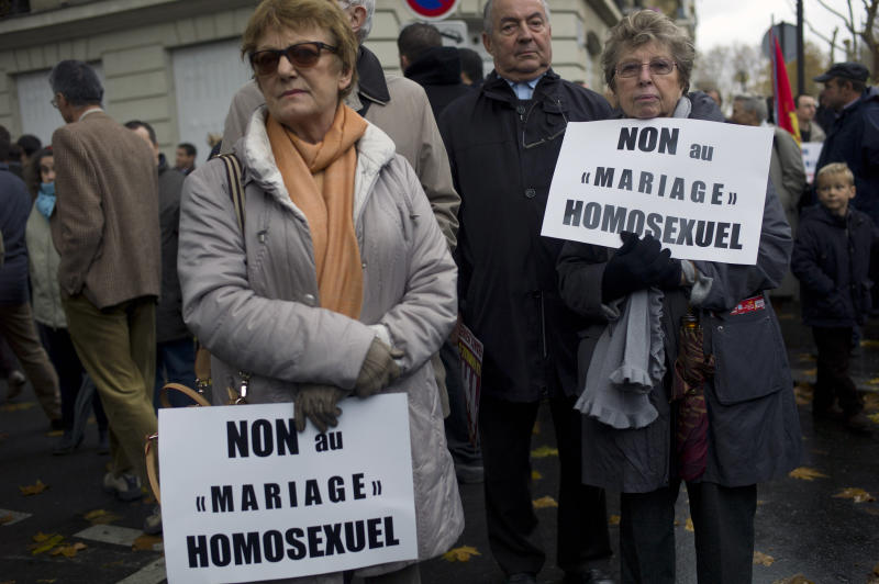 "People hold placards during a protest organized by fundamentalist Christian group Civitas Institute against gay marriage, in Paris, Sunday, Nov. 18, 2012. Placards read: ""No to Homosexual Marriage"". (AP Photo/Thibault Camus)"
