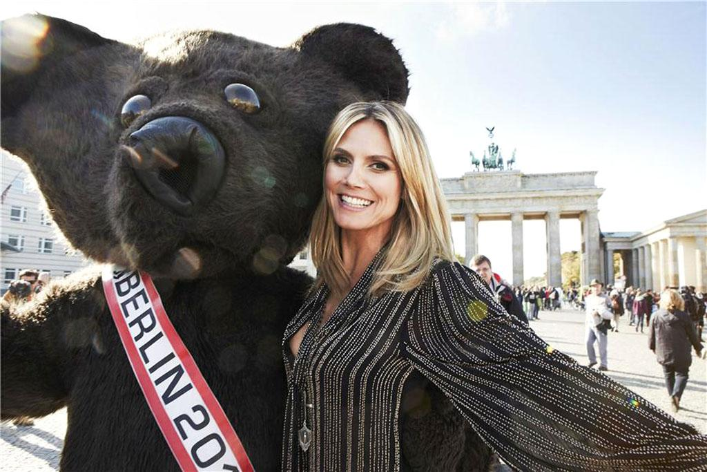 Heidi Klum has gone from loving a Seal to a bear! The German native got cozy with a cuddly life-size teddy in Berlin on Tuesday while in town to promote Astor Perfect Stay 8-hour lipgloss. (10/16/2012)