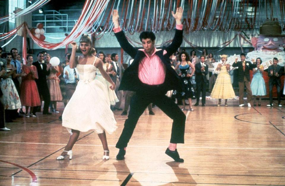 <p>It wasn't all poodle skirts and cardigans in <em>Grease—</em>Olivia Newton-John also wore a pale-yellow spaghetti-strap dress in the movie's famous hand jive dance sequence that we'd honestly still wear today.</p>