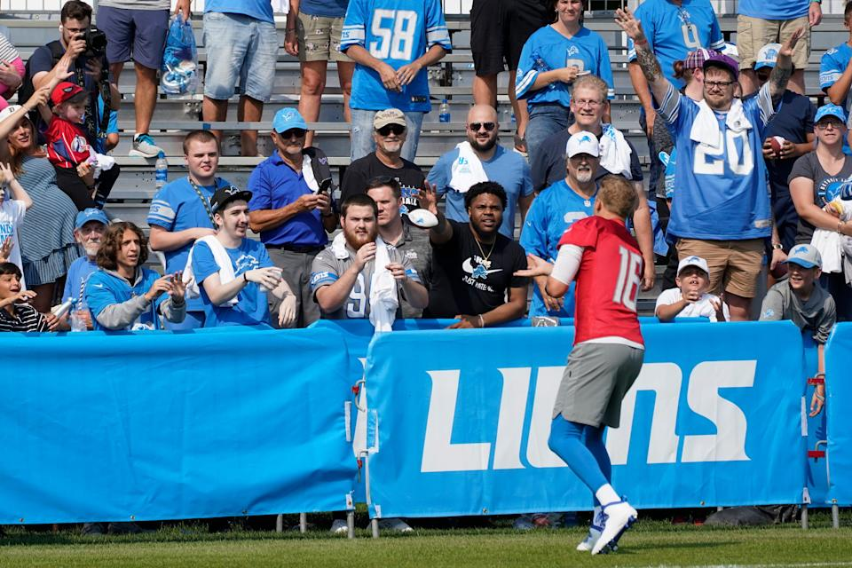 Lions quarterback Jared Goff throws a football to fans after training camp practice in Allen Park on Saturday, July 31, 2021.