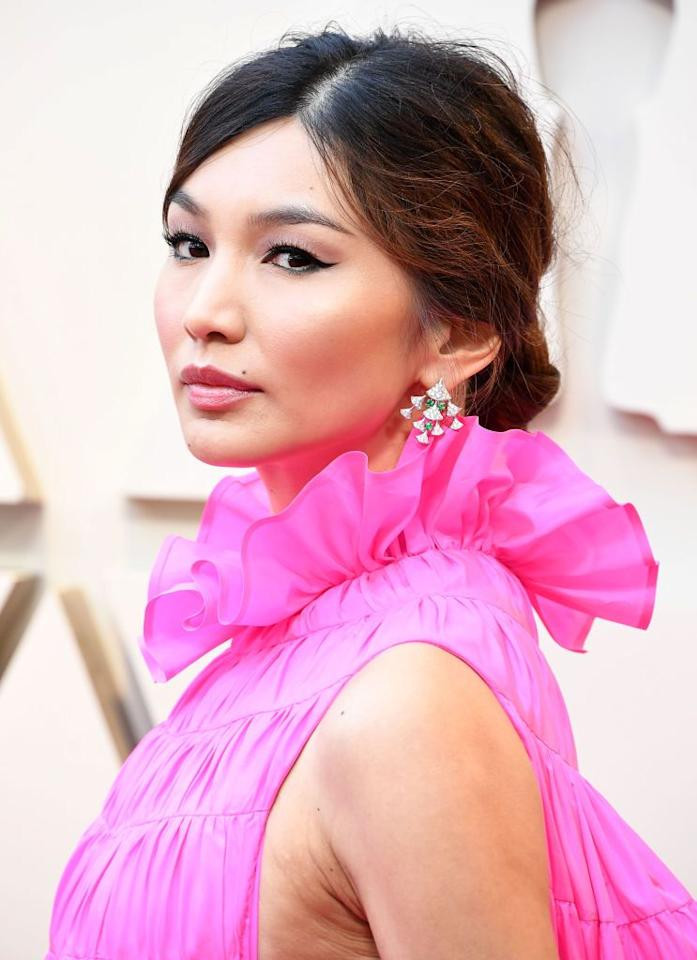 """<p>Classic, sophisticated, and romantic. This mussed, low bun is as chic as can be-especially when paired with a brightly colored dress, a la Gemma Chan at the Oscars. </p><p><strong>Try: O&M</strong> Frizzy Logic Shine Serum, $32, <a class=""""body-btn-link"""" href=""""https://go.redirectingat.com?id=74968X1596630&url=https%3A%2F%2Fwww.net-a-porter.com%2Fus%2Fen%2Fproduct%2F901143%3Fgclsrc%3Daw.ds%26gclsrc%3Daw.ds%26cm_mmc%3DGoogle-ProductSearch-US--c-_-NAP_EN_US_PLA-_-NAP%25C2%25A0-%25C2%25A0US%25C2%25A0-%25C2%25A0GS%25C2%25A0-%2BDesigner%2B-%2BClass_Beauty%2B-%2BType_Haircare%25C2%25A0-%25C2%25A0High%25C2%25A0-%25C2%25A0BT--Haircare%2B-%2BStyling_AM%26gclid%3DCjwKCAjwlPTmBRBoEiwAHqpvhZI0TzUSXmWiLmOMi6Hi7Dl0Xr12tHNB8iv_CnVGsAmWDZZH_JuA-RoCC04QAvD_BwE&sref=http%3A%2F%2Fwww.harpersbazaar.com%2Fwedding%2Fbridal-beauty%2Fg27496366%2Fwedding-guest-hairstyles-ideas%2F"""" target=""""_blank"""">SHOP</a> </p>"""