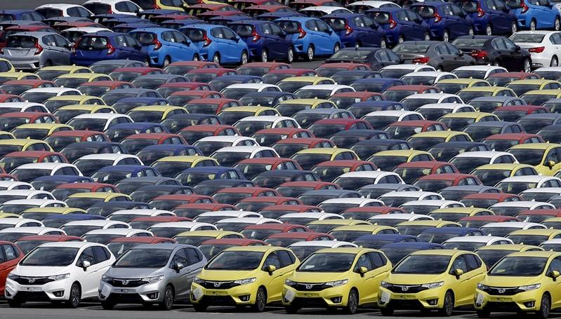 FILE PHOTO: Newly manufactured cars of the automobile maker Honda await export at port in Yokohama