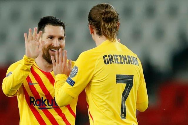 Lionel Messi, left, brought Barcelona level on the evening (Christophe Ena/AP/PA)