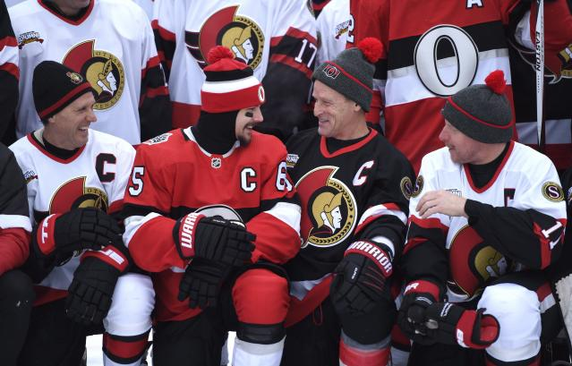 <p>Just a few captains past and present sharing a laugh. Erik Karlsson, Randy Cunneyworth, Daniel Alfredsson and Laurie Boschman relay some words of wisdom before posing for a group photo on Friday. </p>