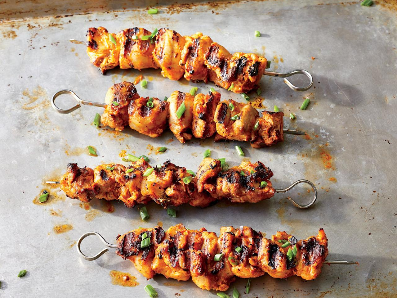 """<p>These skewers get a nice, long marinating time due to the low amount of lemon juice. If your marinade is loaded with vinegar or citrus, go for 30 minutes to an hour at most to ensure the best texture.</p> <p><a href=""""https://www.myrecipes.com/recipe/harissa-grilled-chicken-skewers"""">Harissa Grilled Chicken Skewers Recipe</a></p>"""
