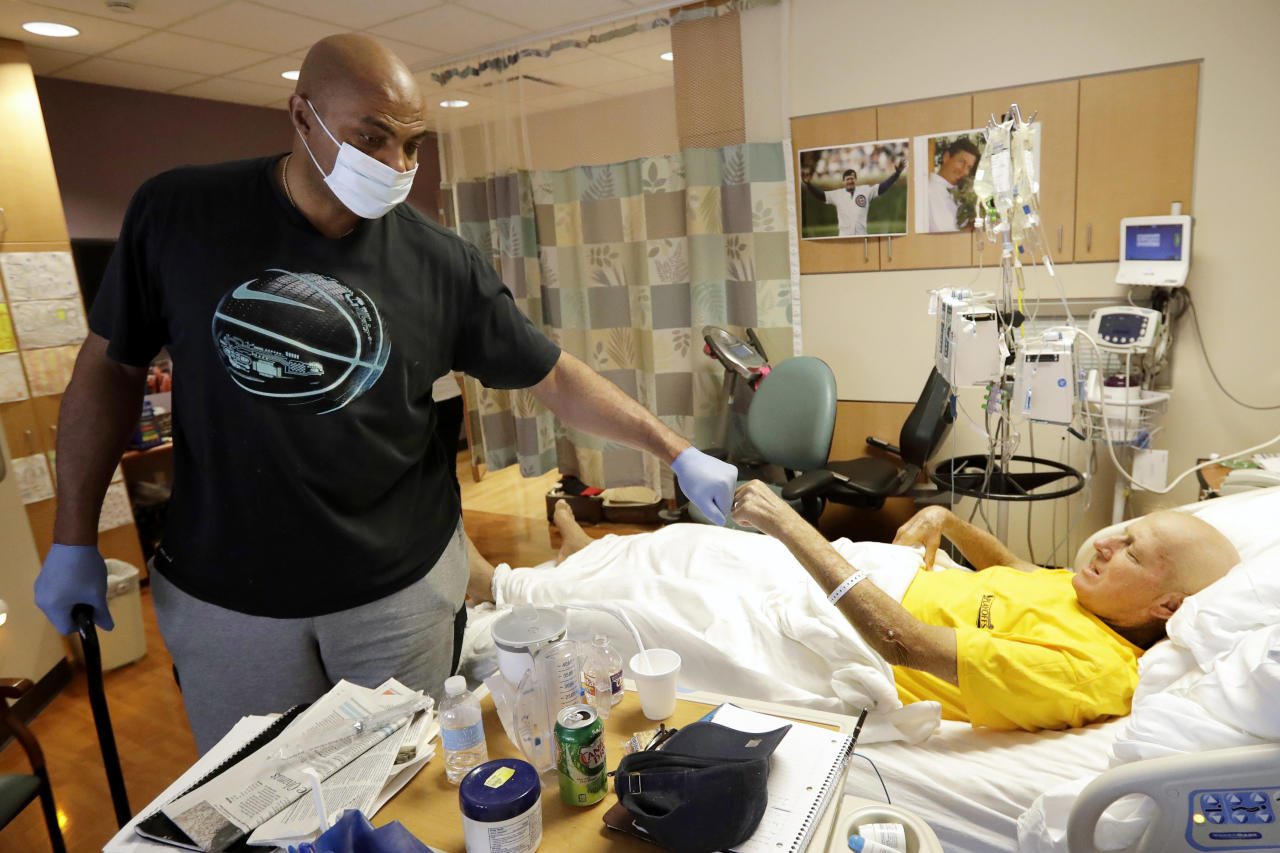 NBA Hall of Fame member and TNT colleague Charles Barkley left, bumps fists with sportscaster Craig Sager after visiting Sager Tuesday, Aug. 30, 2016, at MD Anderson Hospital in Houston. Sager underwent his third bone marrow transplant Wednesday, Aug. 31, 2016, as he continues to battle acute myeloid leukemia. (AP Photo/David J. Phillip)