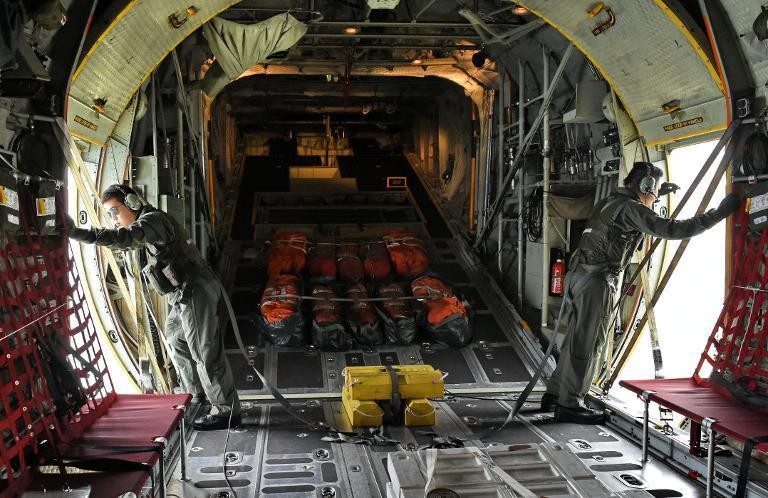Republic of Singapore Air Force (RSAF) servicemen onboard a C-130 aircraft take part in the search and locate (SAL) operation for missing AirAsia flight QZ8501 over the Java Sea on December 30, 2014