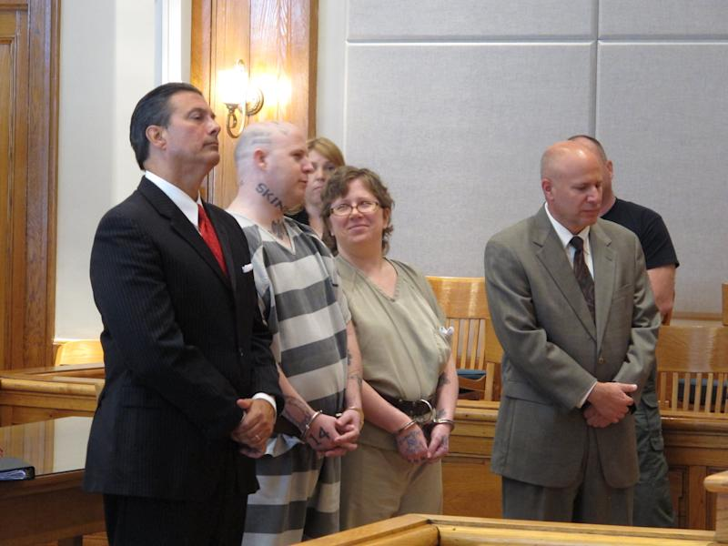 From left, lawyer Harry Dest, Jeremy Moody, Christine Moody and lawyer Derek Chiarenza wait for a judge to sentence the Moody's to life in prison on Tuesday, May 6, 2014, in Union, S.C. Prosecutors said the husband and wife killed Charles Parker in his home in July 2013 because he was a sex offender and his wife Gretchen Parker because she was there. (AP Photo/Jeffrey Collins)