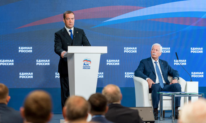 Russian Security Council Deputy Chairman and the head of the United Russia party, Dmitry Medvedev, left, speaks during a joint session of the Supreme Council and the General Council of United Russia party in Moscow, Russia, Wednesday, June 9, 2021. Chairman of the Supreme Council of United Russia Boris Gryzlov is on the right. (Svetlana Schenkel/Sputnik, Government Pool Photo via AP)