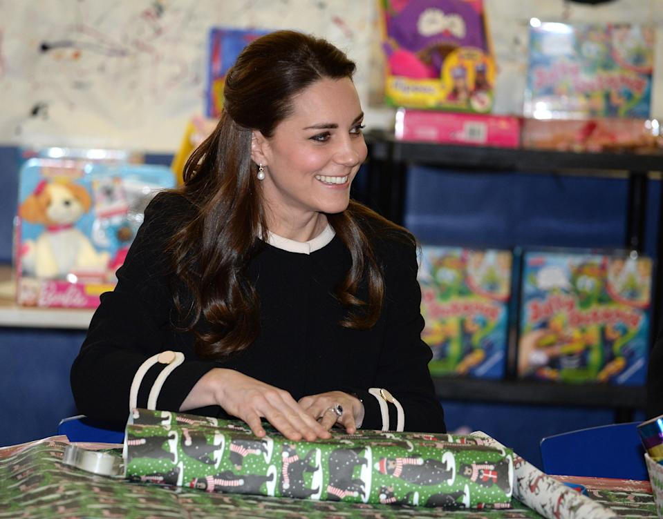 The Duchess of Cambridge wraps presents in New York, in 2013 [Photo: Getty]