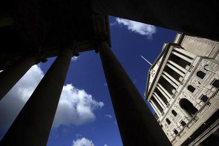 The Bank of England is seen through the columns on the Royal Exchange building in London