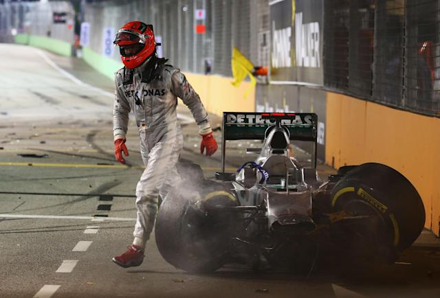 SINGAPORE - SEPTEMBER 23: Michael Schumacher of Germany and Mercedes GP retires early after crashing into the back of Jean-Eric Vergne of France and Scuderia Toro Rosso during the Singapore Formula One Grand Prix at the Marina Bay Street Circuit on September 23, 2012 in Singapore, Singapore. (Photo by Robert Cianflone/Getty Images)