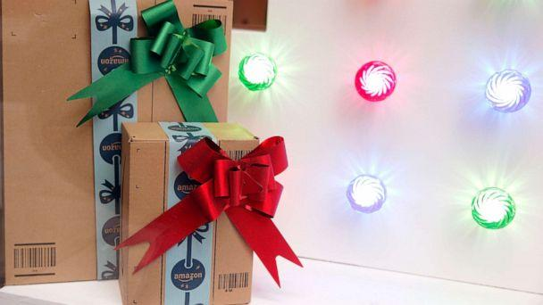 PHOTO: Amazon packages are decorated for the holidays. (Chesnot/Getty Images)