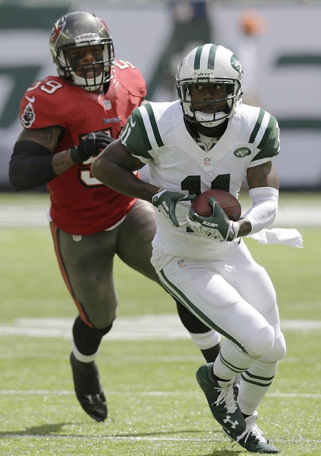 New York Jets wide receiver Jeremy Kerley (11) runs with the ball on a 26-yard reception from quarterback Geno Smith as Tampa Bay Buccaneers middle linebacker Mason Foster (59) chases him during the first half of an NFL football game, Sunday, Sept. 8, 2013, in East Rutherford, N.J. (AP Photo/Mel Evans)