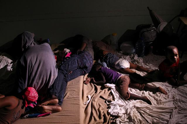 <p>Locals rest inside a shelter before the arrival of the Hurricane Maria in Punta Cana, Dominican Republic, Sept. 20, 2017. (Photo: Ricardo Rojas/Reuters) </p>