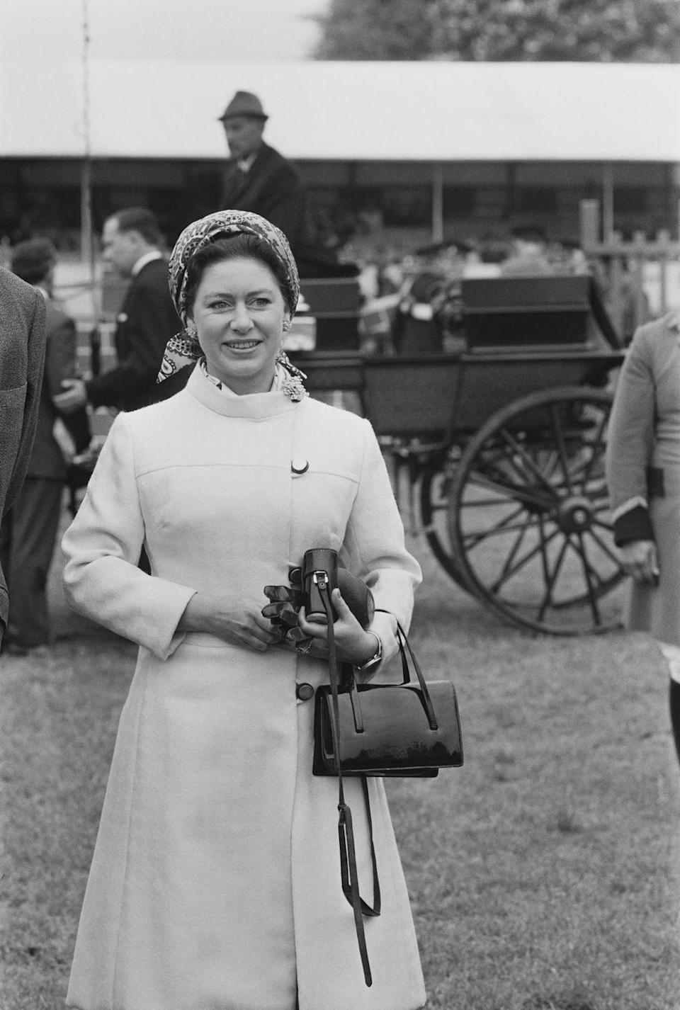 <p>Princess Margaret—and every other member of the royal family, TBH—always brought a purse with her whenever she went out, and this patent-leather number was no exception. The material was a prominent part of British fashion trends in the '60s and became even more popular in the following decade. </p>