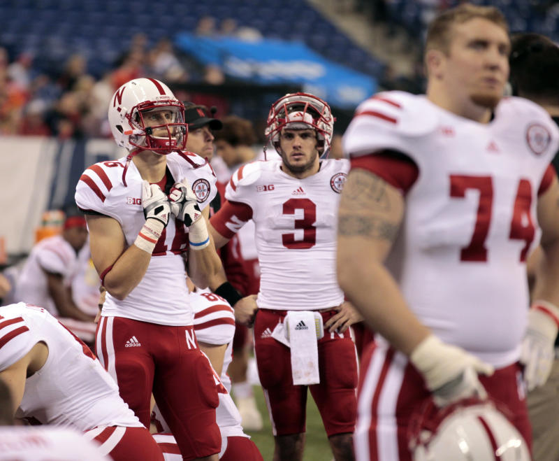 "FILE - This Dec. 1, 2012 file photo shows Nebraska quarterback Taylor Martinez (3) reacting on the sidelines with his teammates near the end of the Big Ten Conference championship NCAA college football game against Wisconsin in Indianapolis.  Nebraska offensive coordinator Tim Beck warns if the Cornhuskers have an emotional hangover from their 39-point Big Ten championship game loss, ""it's going to get ugly"" when they play sixth-ranked Georgia in the Capital One Bowl. (AP Photo/Michael Conroy, File)"