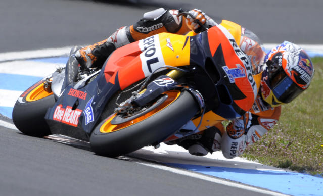 Repsol Honda team's Australian Casey Stoner rides during the Moto GP race of the Portuguese Grand Prix in Estoril, outskirts of Lisbon, on May 6, 2012. Stoner won the race ahead Yamaha Factory Racing team's Spanish Jorge Lorenzo and Repsol Honda rider Spanish Dani Pedrosa. AFP PHOTO / MIGUEL RIOPAMIGUEL RIOPA/AFP/GettyImages