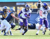 TCU wide receiver Taye Barber (4) rushes the ball against West Virginia during the first half of an NCAA college football game on Saturday, Nov. 14, 2020, in Morgantown, W.Va. (William Wotring/The Dominion-Post via AP)