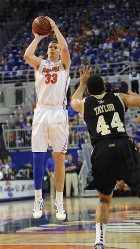 Florida's Erick Murphy (33) shoots a 3-pointer as Vanderbilt's Jeffrey Taylor (44) defends during the first half of an NCAA college basketball game in Gainesville, Fla., Saturday, Feb. 4, 2012. (AP Photo/Phil Sandlin)