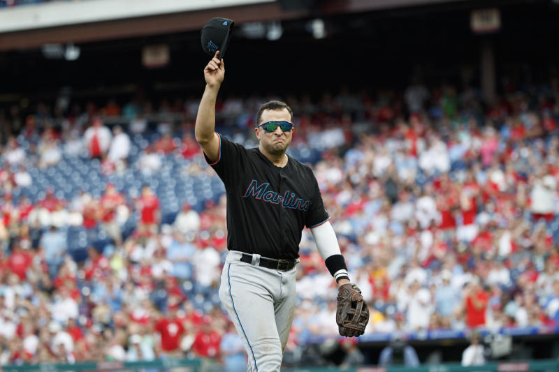 Miami Marlins' Martin Prado tips his cap to the crowd during the ninth inning of a baseball game against the Philadelphia Phillies, Sunday, Sept. 29, 2019, in Philadelphia. (AP Photo/Matt Slocum)