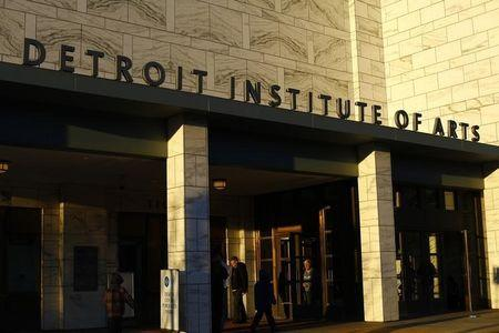 People enter and exit the Detroit Institute of Arts in Detroit