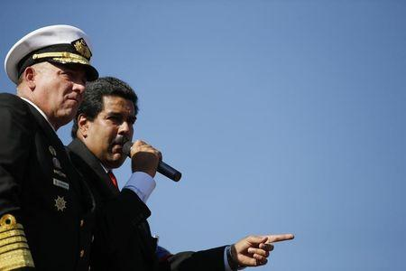FILE PHOTO: Nicolas Maduro stands next to then Defense Minister Diego Molero (L) as he speaks to thousands of supporters of Venezuela's late President Hugo Chavez as they wait to view his body in state at the Military Academy in Caracas March 7, 2013.  REUTERS/Jorge Silva