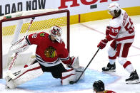 Detroit Red Wings left wing Tyler Bertuzzi, right, scores against Chicago Blackhawks goalie Kevin Lankinen, left, during the second period of an NHL hockey game in Chicago, Sunday, Jan. 24, 2021. (AP Photo/Nam Y. Huh)
