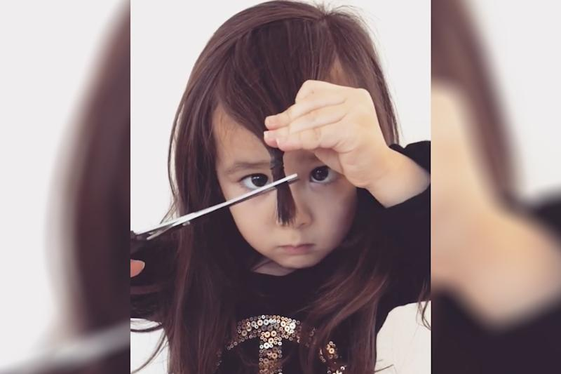 This brave little girl can cut her own bangs. (Photo: Instagram/oa_angel)