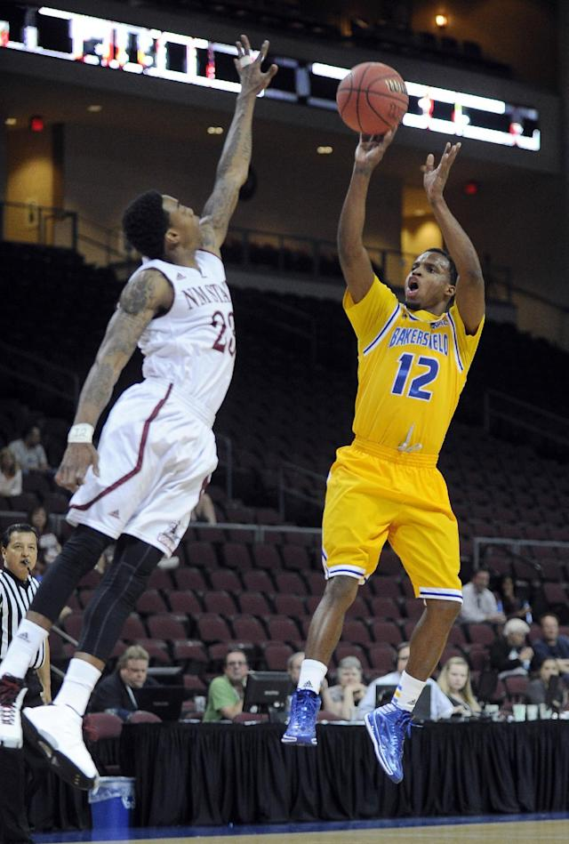 Cal State Bakersfield's Issiah Grayson (12) shoots against New Mexico State's Daniel Mullings during the first half of an NCAA college basketball game in the semifinals of the West Athletic Conference men's tournament Friday, March 14, 2014, in Las Vegas. (AP Photo/David Becker)