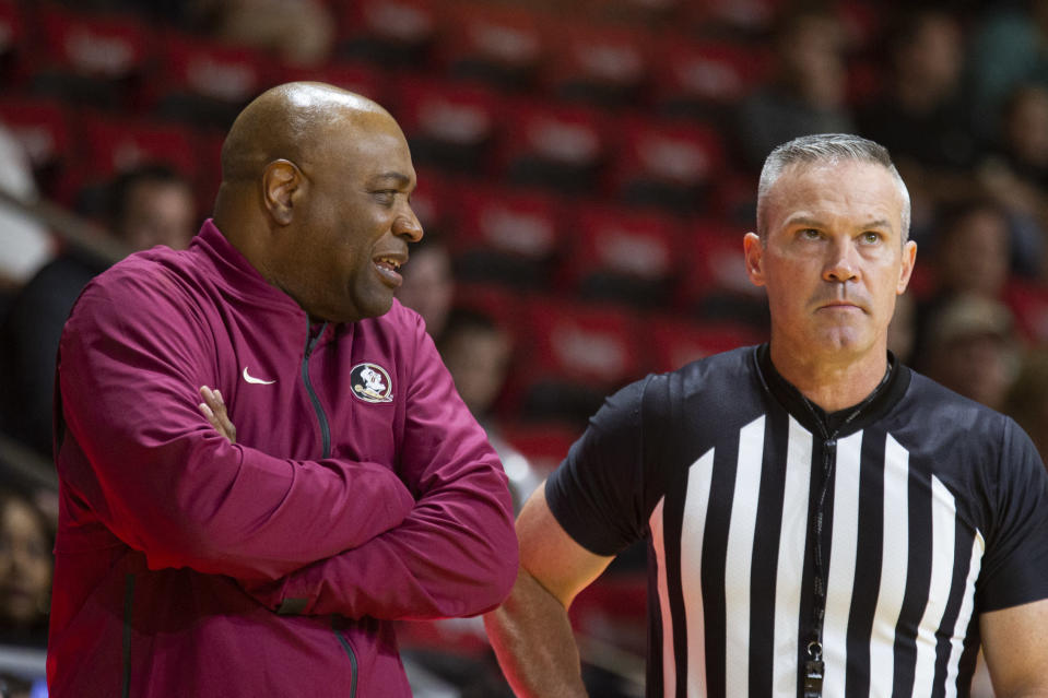 Florida State head coach Leonard Hamilton, left, talks with the referee in the first half of an NCAA college basketball game against Tennessee at the Emerald Coast Classic in Niceville, Fla., Friday, Nov. 29, 2019. (AP Photo/Mark Wallheiser)