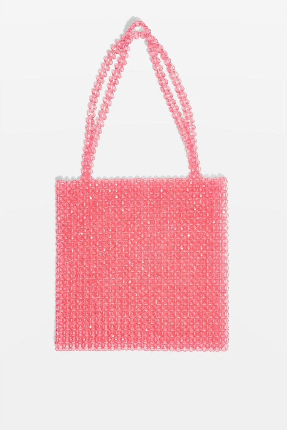 """<p>Bead bags are all the rage at the moment, thanks to Shrimps' now-cult Antonia bag. The great thing about this Topshop version is that it won't set you back £450 like the original. Win. <em><a rel=""""nofollow noopener"""" href=""""http://www.topshop.com/en/tsuk/product/beaded-tote-bag-7638821?geoip=noredirect&cmpid=ppc_pla_UK_ip&utm_medium=cpc&tsrc=vdna&istCompanyId=38aa0d7f-6514-4cb3-bbdc-df0d32d48b7f&istItemId=-xlxmwiriti&istBid=tztx&utm_content=&gclid=EAIaIQobChMI-_rlva7i2gIVDp3tCh27UwLZEAQYASABEgJsGfD_BwE&gclsrc=aw.ds"""" target=""""_blank"""" data-ylk=""""slk:Buy here."""" class=""""link rapid-noclick-resp"""">Buy here.</a> </em> </p>"""