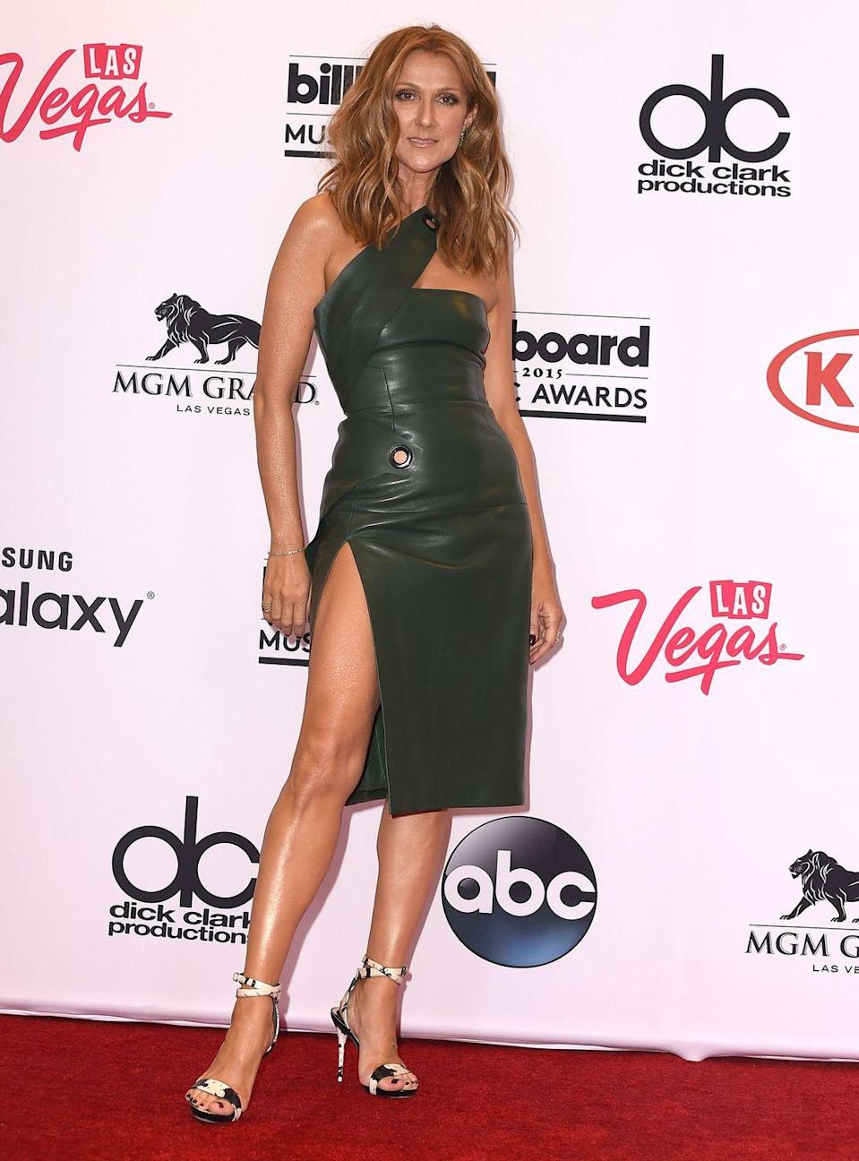 <p>The singer let out her edgy side with a one-shoulder leather minidress and animal-print heels. She covered her arms and legs in body shimmer and <em>literally</em> glowed.</p>