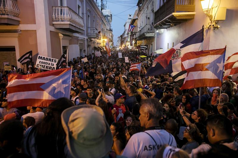 "(Bloomberg) -- Puerto Rico Governor Ricardo Rossello resigned late Wednesday after two weeks of furious protests, throwing the leadership of the U.S. commonwealth into uncertainty as it struggles back from a ruinous hurricane and navigates a $74 billion bankruptcy.Rossello, 40, said in a video on Facebook that he would leave office Aug. 2. He was undone by popular fury after the publication of profane, vengeful and misogynistic text messages among him and his aides that disparaged foes and ordinary residents of the island. The stage was set by corruption investigations that have resulted in the indictment of two former administration officials. But Rossello's exit plunges the island deeper into uncertainty as it tries to revive a recession-scarred economy, pull itself out of bankruptcy and rebuild from 2017's devastating Hurricane Maria.""I was ready to face any challenge, fully understanding that I would prevail in the face of any accusation or legal process,"" Rossello said in his pretaped speech. ""Despite having the mandate of the people who democratically elected me, today I feel that continuing in this position would impede the success of the past from lasting.""According to Puerto Rico's constitution, Justice Secretary Wanda Vazquez will be the next governor, as there is no confirmed secretary of state following an exodus of top officials. Vazquez, 59, has worked in public service more than 30 years, according to spokeswoman Mariana Cobian. But she has been embroiled in the commonwealth's fractious politics and faced her own scandals.RickyRenuncia pic.twitter.com/N3xTHPHPdG— Bloomberg TicToc (@tictoc) July 25, 2019 Rossello ""made the right decision, for the good of both his family and for Puerto Rico,"" Vazquez said in a statement. ""Once the resignation is official, if necessary, I will assume the historic mandate.""The next election will be in 2020. Rossello's decision to depart before that vote was an abrupt about-face after he vowed to remain despite the furor set off by the messages disclosed two weeks ago by Puerto Rico's Center for Investigative Journalism.Next TargetsRickyRenuncia pic.twitter.com/cGBZQJGNJJ— Bloomberg TicToc (@tictoc) July 25, 2019 Tens of thousands flooded San Juan's colonial quarter, where they chanted, banged drums and vented. On Wednesday, activists celebrated a people-power victory and said the next targets would be the federal law known as Promesa that permitted the bankruptcy and established a fiscal oversight board pushing for cuts to services and pensions.""This is the first step toward political democracy,"" said Rosa Segui, spokeswoman of the Citizens Victory Movement, begun in March in opposition to the island's two dominant political parties. ""The schemes revealed in the chats question the legitimacy of all the old institutions. Now our demands include the repeal of Promesa and the abolition of the fiscal board.""The political chaos, however, could strengthen the hand of the federal overseers, who have been tasked with imposing austerity as the commonwealth restructures tens of billions of dollars in debt.The board has advocated painful measures to mend the island that's home to 3.2 million U.S. citizens: cuts to primary and secondary education, reduced pension benefits and higher tuition for University of Puerto Rico students. One of Rossello's leaked texts was a series of middle-finger emojis directed at the board.As Rossello moved closer to a resignation yesterday, the judge overseeing the bankruptcy, Laura Taylor Swain, imposed a 120-day pause on a series of legal fights between bondholders, government officials and the board. The litigation, she said could cause ""chaos that I'm trying to tamp down.""While Rossello has clashed with the panel over the budget, such conflicts only underscored Puerto Ricans' feelings of powerlessness and contempt for politicians whose profligacy drove the territory into ruin.The official currently in line to succeed Rossello -- Vazquez, a member of Rossello's New Progressive Party -- has herself been enmeshed with old institutions for decades. She started as a lawyer for the Housing Department. As justice secretary, she modernized the department, reorganized the litigation division and was an advocate for sexual-assault victims, according to the Democratic Attorneys General Association.At OddsBut in 2018, Vazquez faced an ethics investigation over whether she improperly intervened in a case involving a robbery at her daughter and son-in-law's home. She temporarily stepped down, only to be restored after a court found there was no cause for her arrest.She's clashed with the opposition and key members of her own party, including Majority Leader Thomas Rivera Schatz, who has demanded her resignation.""Vazquez and Rossello are cut from the same cloth,"" Representative Manuel Natal, an independent, said Wednesday. ""Resigning is not going to end this crisis or calm the people in the streets. If anything, it's going to intensify it.""Juan Lara, a University of Puerto Rico economist, said, ""We will have a virtually symbolic, largely ceremonial, governor for 17 months.""It will continue a star-crossed stretch. Rossello, who had made unpopular cuts to foster a debt restructuring, was weakened in his last days by the resignation of key staff members. After the disclosure of the text messages, the administration lost its investment officer, press secretary and two fiscal agency heads -- one of whom lasted just five days. The governor's chief of staff quit Tuesday night. The treasury secretary was fired last month after disclosing a federal corruption investigation into his department.Hot ProductThe island, which collapsed into bankruptcy in 2017, built up $74 billion in debt and $50 billion of pension liabilities. The pileup happened because lawmakers borrowed instead of finding ways to balance budgets and fund the retirement system. At the same time, investors were eager to buy the commonwealth's bonds, which are exempt from local, state and federal taxes in all U.S. states. Wall Street greased the path to debacle, reaping more than $900 million in fees to manage $126.6 billion of bond sales since 2000.Rossello took office two years ago facing the gargantuan task of revitalizing the economy and reining in ballooning debts. He also faced the legacy of his own father, former governor Pedro Rossello, who saddled the island with expensive developments between 1993 and 2001.Rossello, who has a Ph.D in biomedical engineering from the University of Michigan, moved home in 2011, leaving post-graduate work at Duke University for a professorship at the University of Puerto Rico's medical campus. He founded a group advocating more autonomy for the island and began to think of running for governor. He took 42% of the vote in 2016, enough to claim victory in a six-way race.Rossello told Bloomberg News in a 2017 interview that he was wary of ""that one loose screw over here or there to sort of make the whole of government collapse.""If it didn't collapse Wednesday night, it certainly shook.""It's a momentous event for Puerto Rico, the first time a governor has been forced to resign by a popular movement,"" said Juan Angel Giusti-Cordero, a University of Puerto Rico history professor. ""We have discovered the formula for direct democracy, in a two-party and very controlled electoral system that has little leeway for popular participation. And the politicians realize this will probably not be that last time, which is what really scares them.""After Rossello's speech was broadcast, thousands danced, sang and embraced in Old San Juan's Plaza de Armas.""This feels like releasing yourself from the mistakes of so many years,"" said Luis Ortiz, a 30-year-old from Dorado. ""We used to sit back and take it, but we finally stood up.""(Adds role of federal oversight board starting in ninth paragraph.)\--With assistance from Ezra Fieser and Steven Church.To contact the reporters on this story: Michael Deibert in San Juan at mdeibert@bloomberg.net;Michelle Kaske in New York at mkaske@bloomberg.net;Amanda Albright in New York at aalbright4@bloomberg.netTo contact the editors responsible for this story: Vivianne Rodrigues at vrodrigues3@bloomberg.net, ;Shannon D. Harrington at sharrington6@bloomberg.net, Stephen Merelman, Michael B. MaroisFor more articles like this, please visit us at bloomberg.com©2019 Bloomberg L.P."