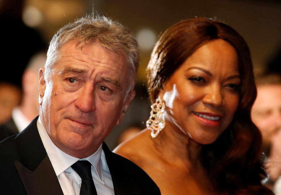 """Cast member Robert De Niro and his wife Grace Hightower pose on the red carpet as they arrive for the screening of the film """"Hands of Stone"""" out of competition at the 69th Cannes Film Festival in Cannes, France, May 16, 2016.  REUTERS/Eric Gaillard"""