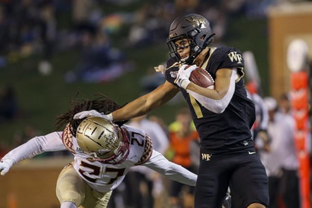 Wake Forest wide receiver Sage Surratt, right, stiff arms Florida State defensive back Akeem Dent after a catch in the first half of an NCAA college football game in Winston-Salem, N.C., Saturday, Oct. 19, 2019. (AP Photo/Nell Redmond)
