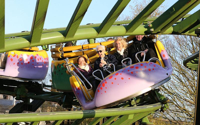 Jack Reynolds (second left) rides the Twistersaurus rollercoaster to raise money for the Derbyshire, Leicestershire and Rutland Air Ambulance - Credit: Nigel Roddis/PA Wire