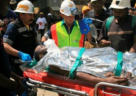 Image result for Death toll in South Africa's illegal mining accident rises to 31