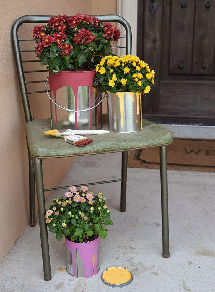"""<p>There's nothing quite like an abundance of mums to make your front yard look ripe for fall. </p><p><a class=""""link rapid-noclick-resp"""" href=""""https://www.dreamalittlebigger.com/post/flowering-paint-cans-easy-fall-color.html"""" rel=""""nofollow noopener"""" target=""""_blank"""" data-ylk=""""slk:GET THE TUTORIAL"""">GET THE TUTORIAL</a></p>"""