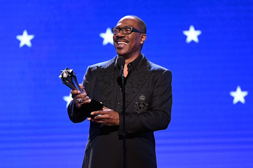 SANTA MONICA, CALIFORNIA - JANUARY 12: Eddie Murphy accepts the Lifetime Achievement Award onstage during the 25th Annual Critics' Choice Awards at Barker Hangar on January 12, 2020 in Santa Monica, California. (Photo by Kevin Winter/Getty Images for Critics Choice Association)