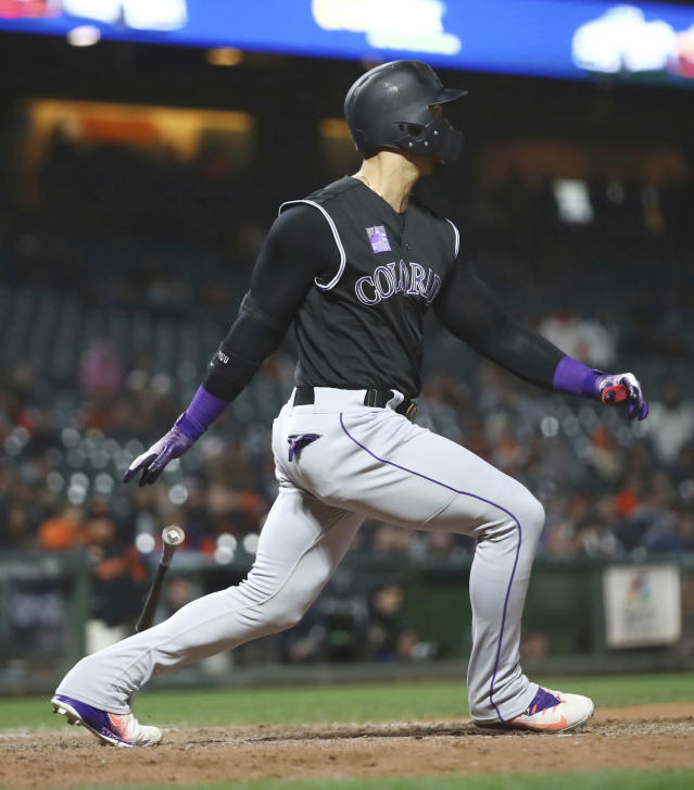 Colorado Rockies' Carlos Gonzalez swings for a two run single against the San Francisco Giants in the 12th inning of a baseball game Thursday, May 17, 2018, in San Francisco. (AP Photo/Ben Margot)