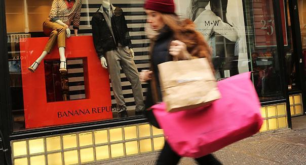 NEW YORK, NY - FEBRUARY 07: A shopper walks down Broadway on February 7, 2013 in New York City. In another indicator of a slowly strengthening economy, chain stores including Macy's Inc., Target Corp and Gap Inc. reported today January sales that exceeded analysts' estimates. (Photo by Spencer Platt/Getty Images) Banana Republic