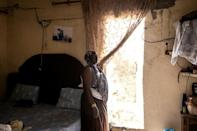 Mareme Gueye, 43, says six of the seven rooms in her house are gone, washed away by the ocean (AFP/JOHN WESSELS)