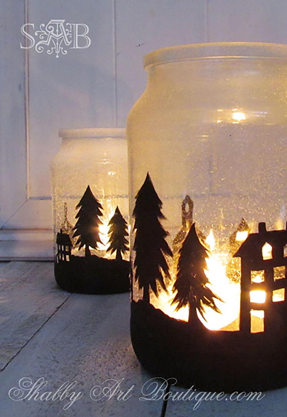 """<p>Blogger Kerryanne English set a snowy scene in her home by illuminating a stencil she glued to the outside of jar lit up with a tea light candle.</p><p><strong>Get the tutorial at <a href=""""http://shabbyartboutique.com/2014/11/its-no-secret-women-love-candles.html"""" rel=""""nofollow noopener"""" target=""""_blank"""" data-ylk=""""slk:Shabby Art Boutique"""" class=""""link rapid-noclick-resp"""">Shabby Art Boutique</a>.</strong> </p><p><a class=""""link rapid-noclick-resp"""" href=""""https://www.amazon.com/Apple-Barrel-Acrylic-Assorted-21148/dp/B0018NBUU2/?tag=syn-yahoo-20&ascsubtag=%5Bartid%7C10050.g.2132%5Bsrc%7Cyahoo-us"""" rel=""""nofollow noopener"""" target=""""_blank"""" data-ylk=""""slk:SHOP BLACK PAINT"""">SHOP BLACK PAINT</a></p>"""