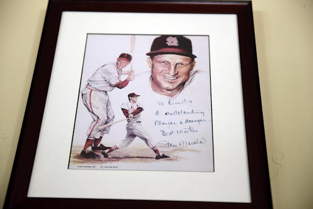 In this March 13, 2014 photo, a framed and signed picture from Stan Musial hangs on a wall at Dusty Baker's home in Granite Bay, Calif. Out of uniform for the first time since taking 2007 off between managerial jobs with the Cubs and Reds, Baker is not slowing down much from his pressure-packed days in the dugout. (AP Photo/Eric Risberg)